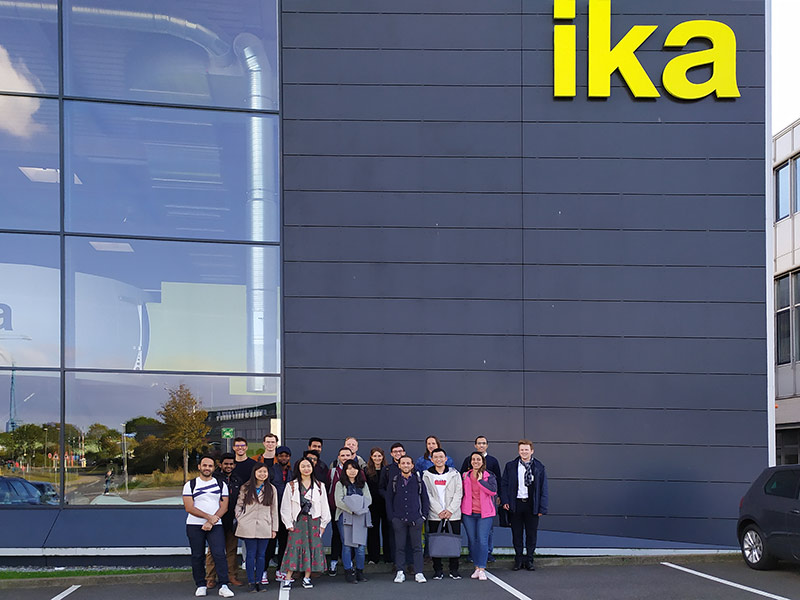 [Photo: Group photo in front of ika]
